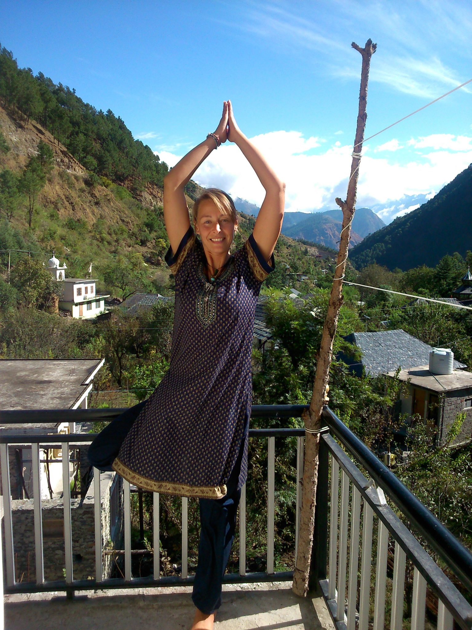 Jez Culley doing yoga in front of some mountains