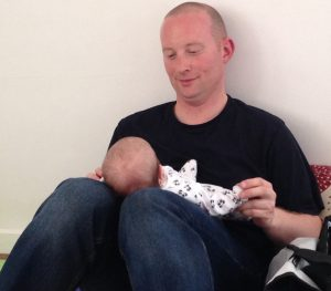 Baby massage with dad Steve