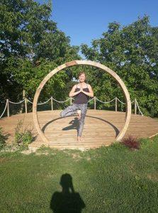 Kim Jones doing yoga in a circle