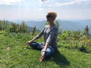 Kim Mackie doing yoga on a mountain