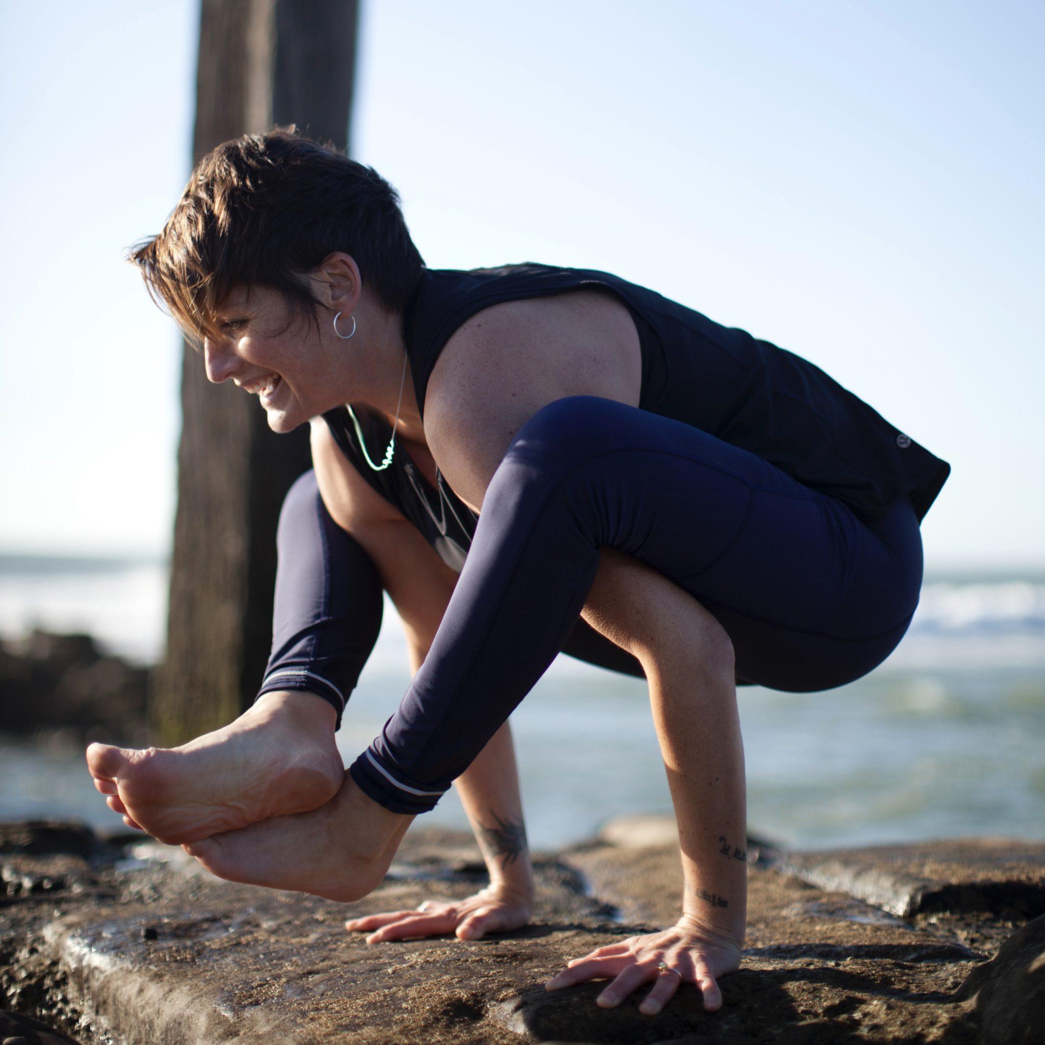 Toni Roberts doing yoga by the sea