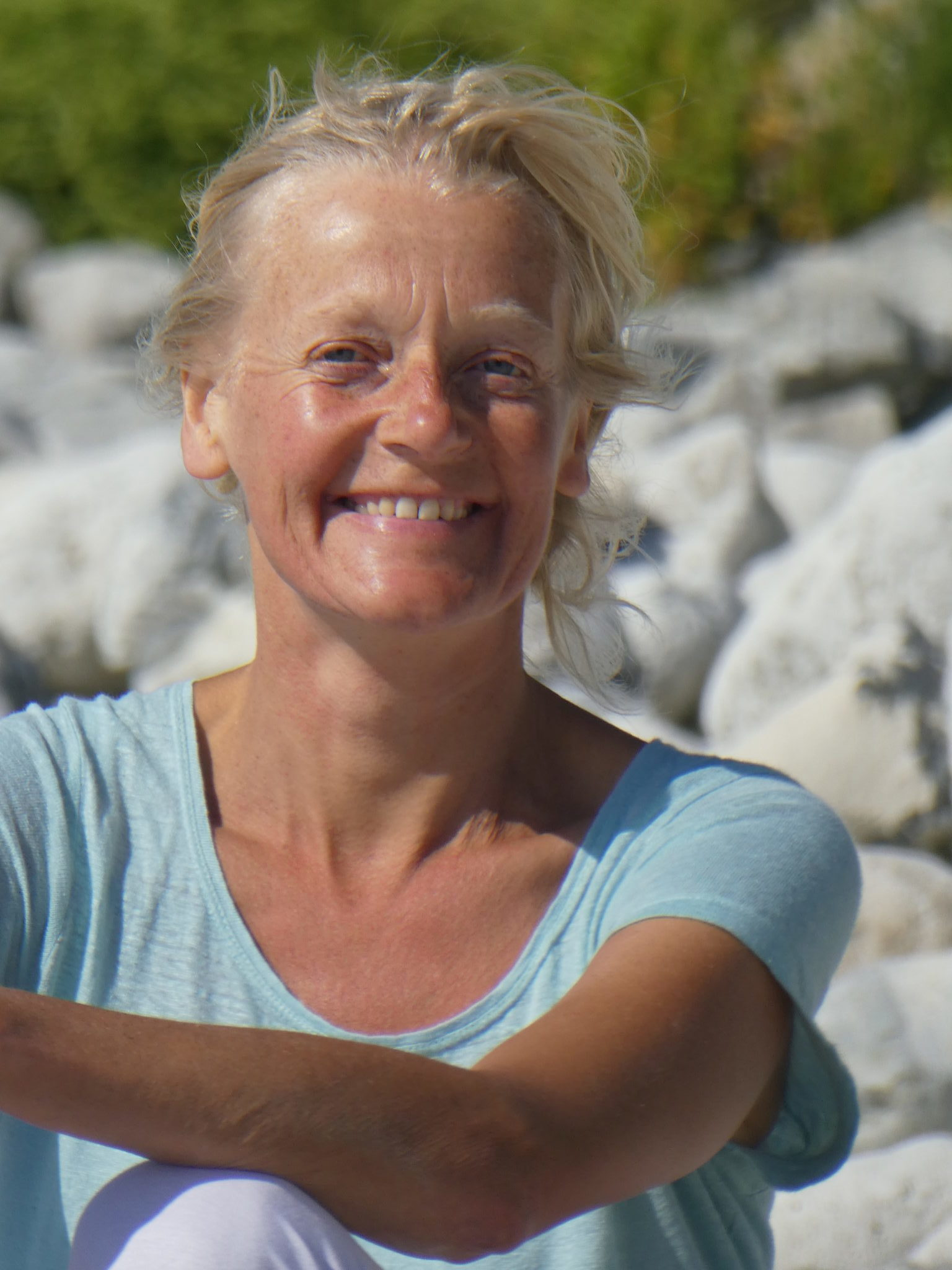 Sian Lalita Alcock smiling on a beach