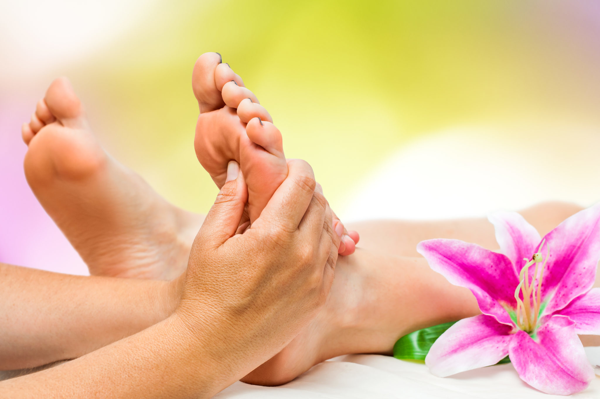 Spa therapist doing foot massage