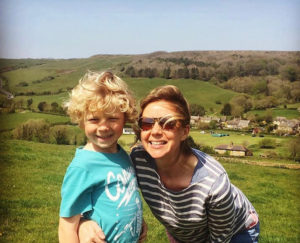 Rebecca Shalts with her son in a field