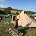 woman doing yoga in a campsite