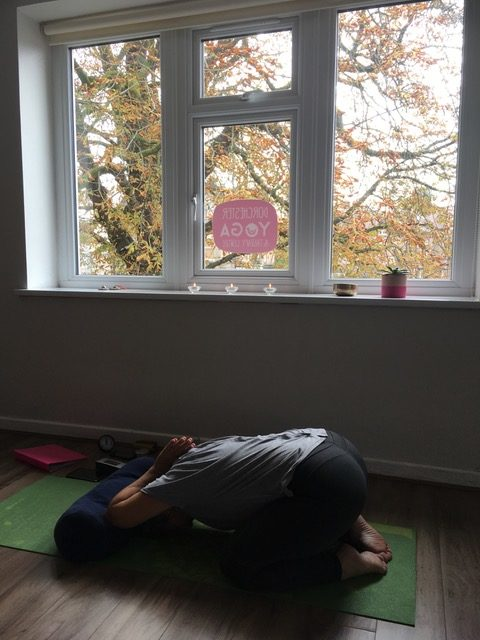 Yoga pose under a window