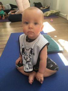 Cute baby doing yoga