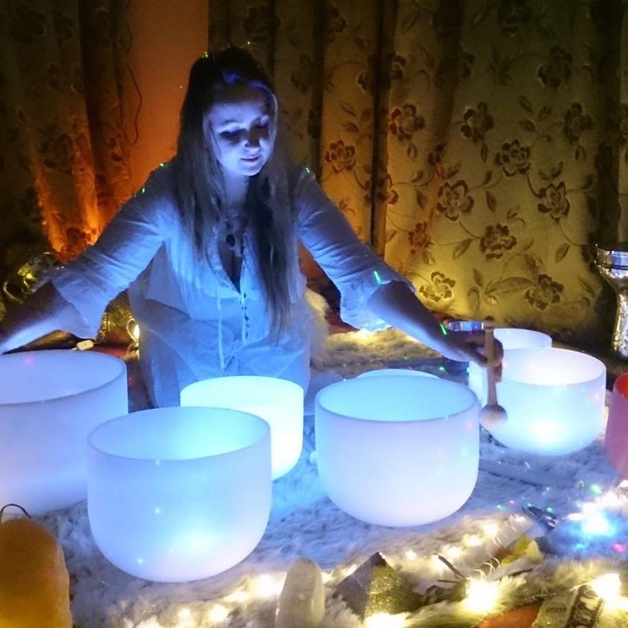 Bex Leonard playing her crystal bowls