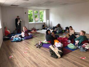 baby massage group in yoga studio