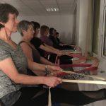 Yoga group doing leg stretches