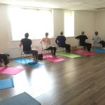 Chair yoga group doing twists