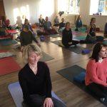 Group yoga class meditating
