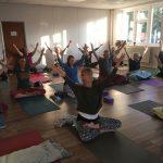 Yoga Class raising their hands