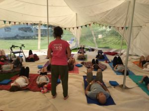 Yoga class in a tent at Dorset Fest